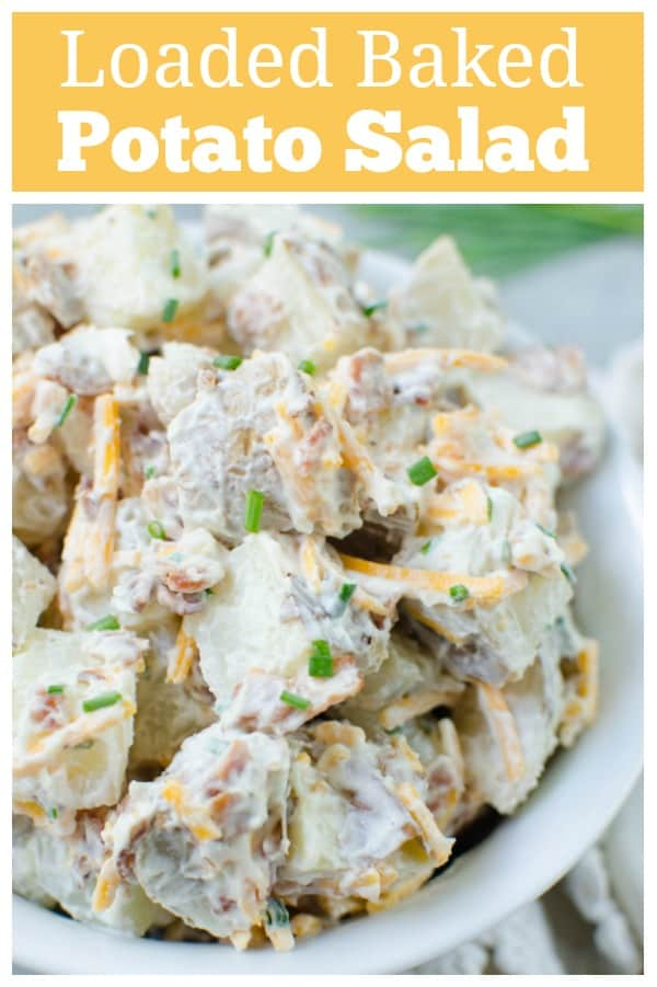 Baked Potato Salad - everything you love about baked potatoes in a potato salad! Potatoes tossed in sour cream, bacon, cheddar cheese, and chives. Perfect for summer barbecues!