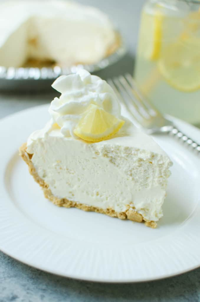 Frozen Lemonade Pie - only 4 ingredients and no bake! Graham cracker crust with a sweet creamy lemonade filling. The perfect summer dessert!