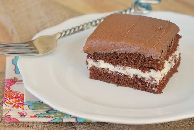 Chocolate Cream-Filled Cake - this cake tastes like a Little Debbie Swiss Cake Roll! Chocolate cake with vanilla cream filling and chocolate buttercream.