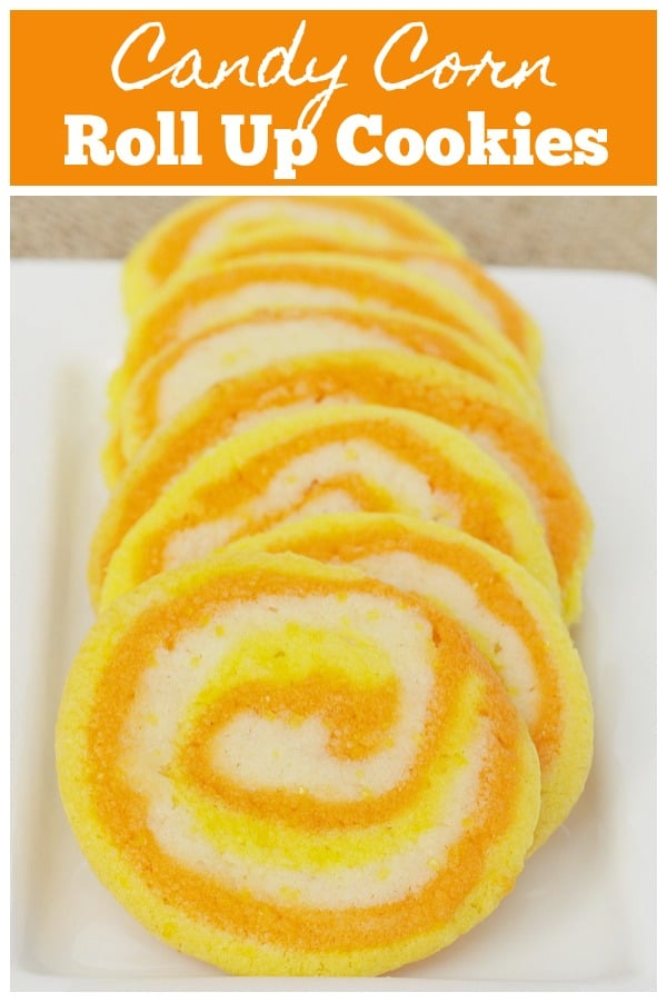 Candy Corn Roll Up Cookies - the cutest Halloween cookies! Sugar cookie dough is dyed yellow and orange and rolled together before baking. These are easy and so fun!