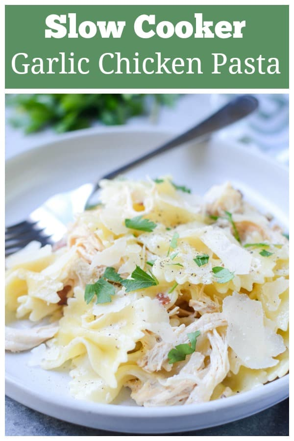 Slow Cooker Garlic Chicken Farfalle - slow cooker chicken shredded and tossed with pasta, bacon, cream, Parmesan cheese, and black pepper.