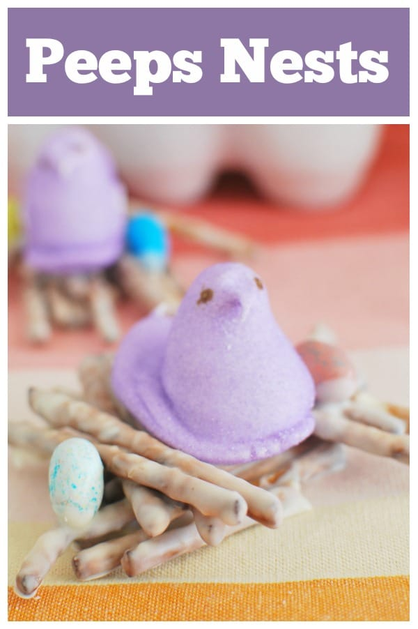 Peeps Nests - the cutest Easter treat! White chocolate covered pretzels with Peeps and candy eggs on top. No bake and perfect for school Easter parties!