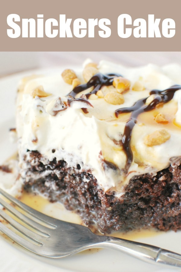 Snickers Cake - chocolate poke cake filled with sweetened condensed milk and caramel. It's topped with whipped cream and chopped Snickers! Plus, peanuts, caramel sauce, and hot fudge on top!