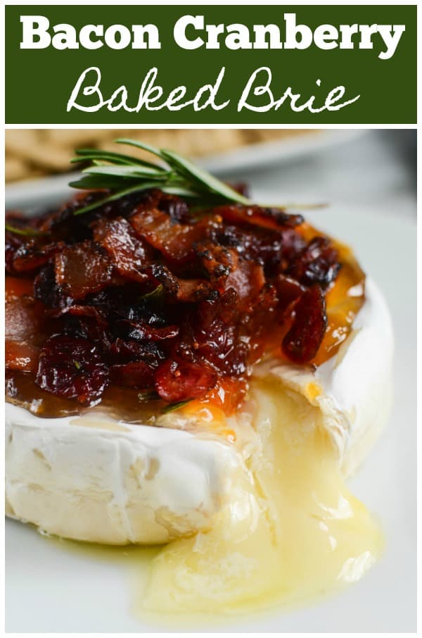 Bacon Cranberry Baked Brie - the perfect holiday appetizer! Brie topped with bacon, dried cranberries, apricot preserves, fresh rosemary and then baked until melty and delicious.