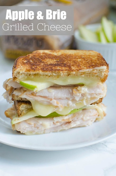 Apple and Brie Grilled Cheese - the perfect fall sandwich recipe! Turkey, brie, and fresh apple slices. Plus, a honey drizzle!