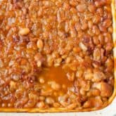 Root Beer Baked Beans - the best barbecue side dish! Beans with bacon, root beer, and barbecue sauce are baked until the sauce is thick and delicious.