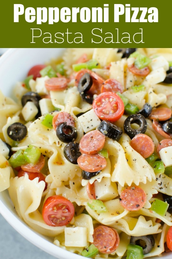 Pepperoni Pizza Pasta Salad - the perfect side dish for all your summer barbecues! Pasta tossed with mini pepperoni, black olives, green bell pepper, tomatoes, mozzarella cheese, and Italian dressing.