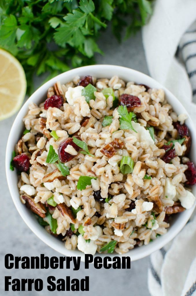 Farro Salad with Cranberries, Feta, and Pecans - a great holiday side dish recipe! Farro tossed with dried cranberries, feta cheese, and pecans in a light lemony dressing.