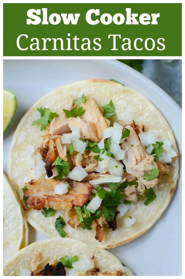 Slow Cooker Carnitas Street Tacos - like from your favorite taco truck! Pork carnitas cooked in the crockpot and piled on corn tortillas with diced onion and cilantro.