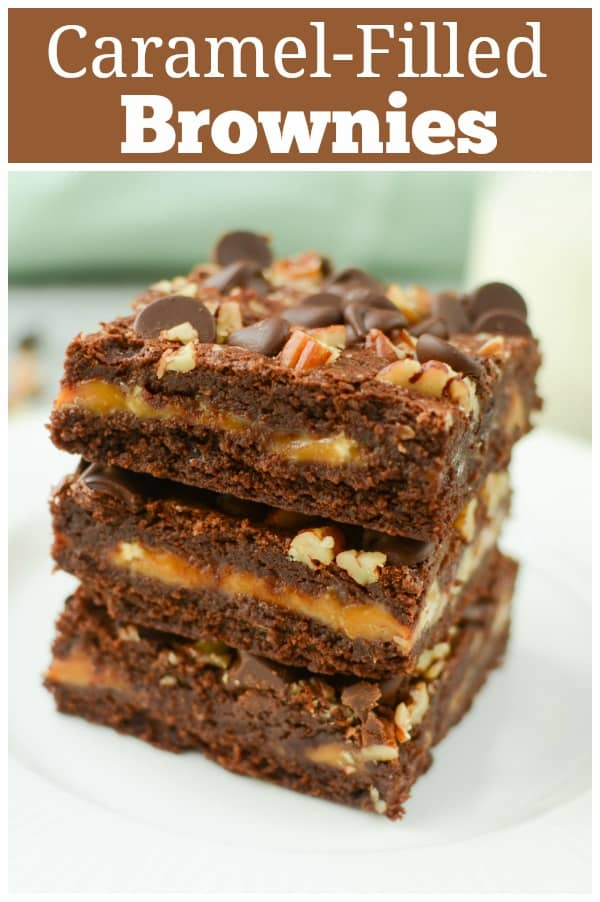 Caramel-Filled Brownies - rich chocolate brownied filled with a layer of caramel and topped with pecans and chocolate chips! These are a must make for caramel lovers!