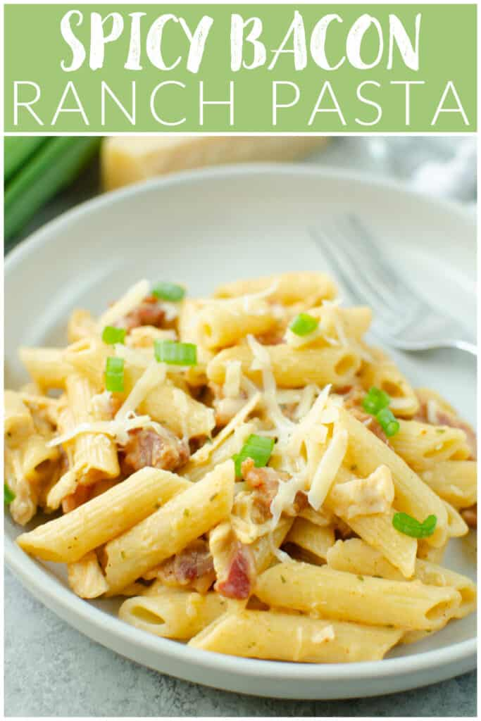 Spicy Bacon Ranch Pasta - pasta tossed with crispy bacon, chicken, Parmesan cheese, and a spicy ranch sauce! My kids LOVE this recipe. And it's ready in about 30 minutes!